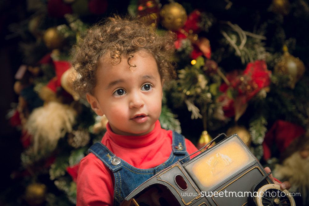 Girl in front of Christmas tree - Cyprus children and family Photography by Sweetmama