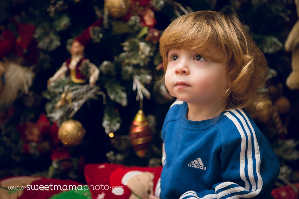 Boy in front of Christmas tree - Cyprus children and family Photography by Sweetmama