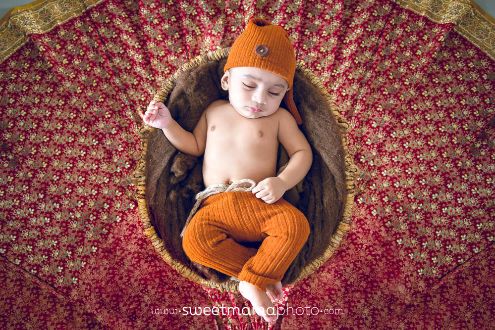 Newborn, baby, and family portrait by Cyprus-based Family portrait boutique Sweetmama Photography